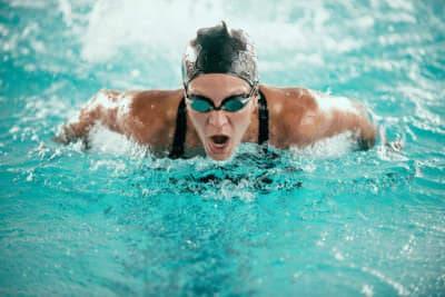 bigstock-butterfly-stroke-swimming-cham-121308716
